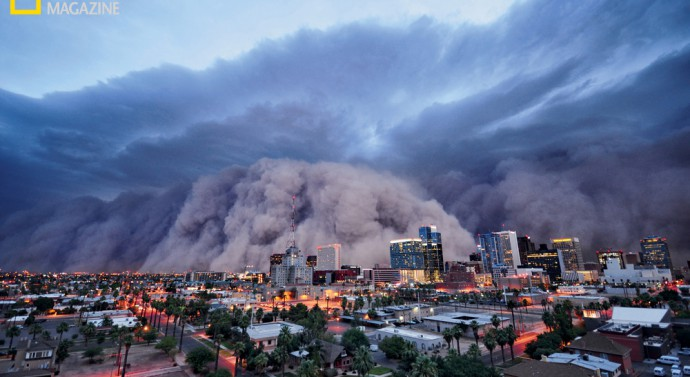 The biggest dust storm in living memory rolls into Phoenix on July 5, 2011, reducing visibility to zero. Desert thunderstorms kicked up the mile-high wall of dust and sand. ©Daniel Bryant