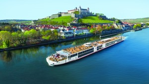 Viking Longship Kvasir near the town of Wurzburg, Germany along the Main River with Marienberg Fortress in the background